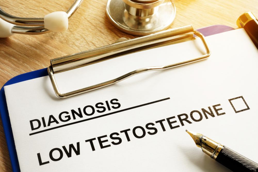 Diagnosis of Low testosterone on clipboard and pen on a desk.